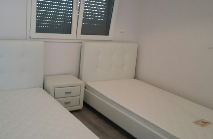 2 single beds in 2nd bedroom